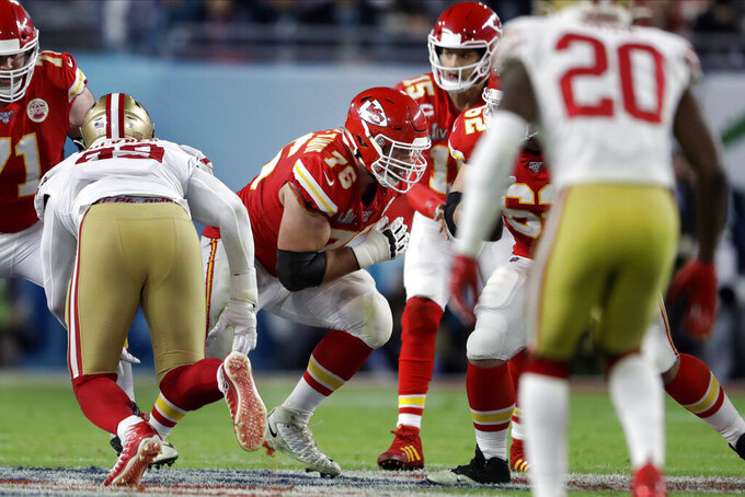 FILE - In this Feb. 2, 2020, file photo, Kansas City Chiefs offensive guard Laurent Duvernay-Tardif, center, blocks against the San Francisco 49ers during the first half of the NFL Super Bowl 54 football game in Miami Gardens, Fla. Duvernay-Tardif has gone from the offensive line to the front line, using the medical degree he completed during offseasons with the Super Bowl champion Chiefs to help patients during the COVID-19 pandemic. (AP Photo/John Bazemore, File)