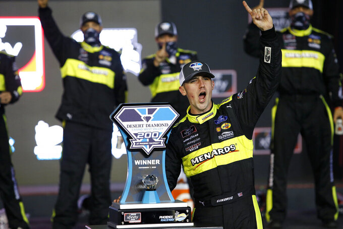 Austin Cindric celebrates in Victory Lane with the race trophy after winning a NASCAR Xfinity Series auto race at Phoenix Raceway, Saturday, Nov. 7, 2020, in Avondale, Ariz. (AP Photo/Ralph Freso)