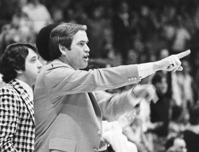In this 1975-76 season photo, Wake Forest coach Carl Tacy coaches the Deacons during the an NCAA college basketball game. Tacy, the Former Wake Forest and Marshall basketball coach, died died early Thursday, April 2, 2020. He was 87. (The Winston-Salem Journal via AP)