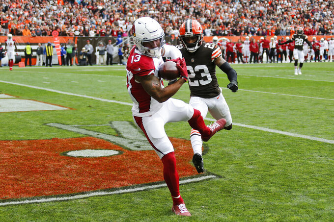 Arizona Cardinals wide receiver Christian Kirk (13) catches a 21-yard touchdown pass against Cleveland Browns cornerback Troy Hill (23) during the first half of an NFL football game, Sunday, Oct. 17, 2021, in Cleveland. (AP Photo/Ron Schwane)