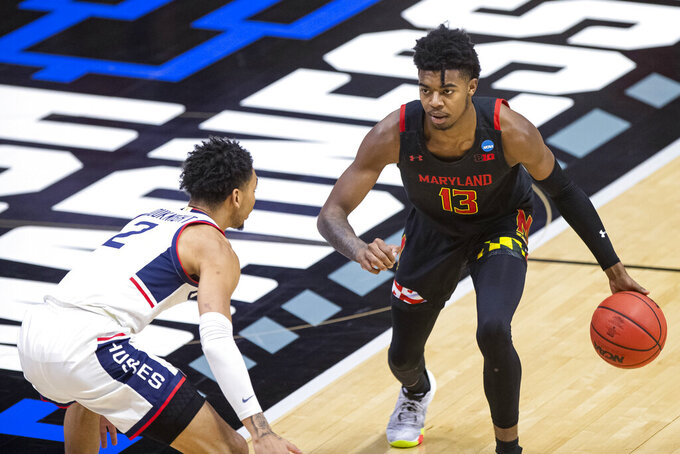 Maryland's Hakim Hart (13) is defended by Connecticut's James Bouknight (2) during the first half of a first-round game in the NCAA men's college basketball tournament Saturday, March 20, 2021, at Mackey Arena in West Lafayette, Ind. (AP Photo/Robert Franklin)