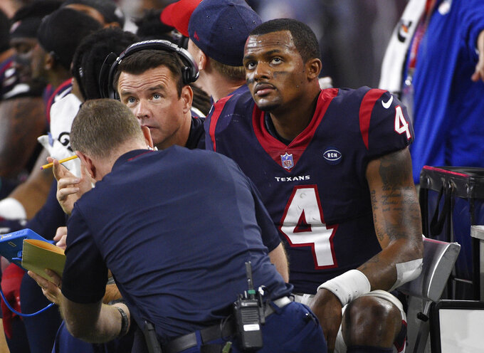 Houston Texans quarterback Deshaun Watson (4) watches from the bench during the second half of an NFL wild card playoff football game against the Indianapolis Colts, Saturday, Jan. 5, 2019, in Houston. Indianapolis won 21-7. (AP Photo/Eric Christian Smith)