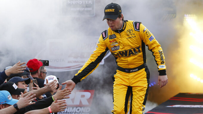 Erik Jones greets fans during driver introductions prior to the start of the NASCAR Cup series auto race at Richmond Raceway in Richmond, Va., Saturday, April 13, 2019. (AP Photo/Steve Helber)