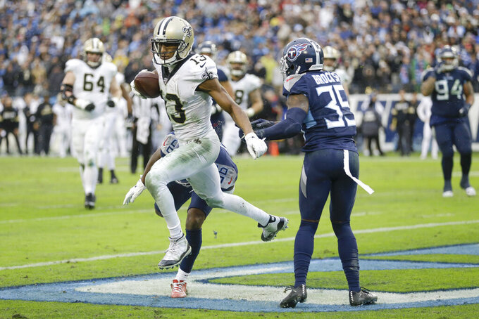 New Orleans Saints wide receiver Michael Thomas (13) scores a touchdown on a 2-yard pass reception ahead of Tennessee Titans cornerback Tramaine Brock Sr. in the second half of an NFL football game Sunday, Dec. 22, 2019, in Nashville, Tenn. The Saints won 38-28. (AP Photo/James Kenney)