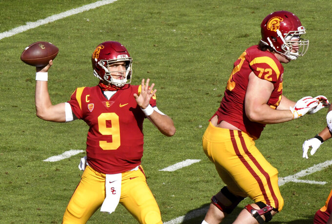 Quarterback Kedon Slovis #9 of the USC Trojans passes against Arizona State Sun Devils in the first half of a NCAA football game at the Los Angeles Memorial Coliseum in Los Angeles on Saturday, November 7, 2020. (Keith Birmingham/The Orange County Register via AP)
