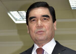 FILE - In this file photo dated Sunday, Feb. 12, 2017, Turkmenistan President Gurbanguly Berdymukhamedov speaks to journalists after casting his ballot at a polling station in Ashgabat, Turkmenistan.  Turkmenistan's autocratic leader Berdymukhamedov has established a national holiday to honor the local dog breed, praising the Central Asian shepherd dog, Alabai, to be celebrated on the last Sunday of April according to Tuesday's news report in the daily Neutral Turkmenistan.  (AP Photo/Alexander Vershinin, FILE)