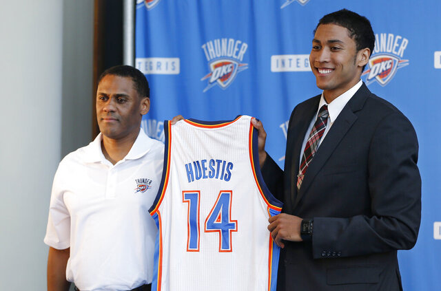 FILE - In this June 27, 2014, file photo, Oklahoma City Thunder vice president and assistant general manager Troy Weaver, left, holds a jersey with forward Josh Huestis as Huestis is introduced during a news conference in Oklahoma City. The Detroit Pistons hired former Oklahoma City Thunder executive Troy Weaver as their new general manager Thursday, June 18, 2020. (AP Photo/Sue Ogrocki, File)