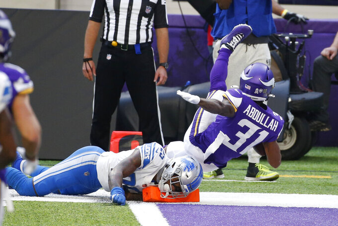 Minnesota Vikings running back Ameer Abdullah (31) scores on a 22-yard touchdown reception ahead of Detroit Lions safety Will Harris, left, during the first half of an NFL football game, Sunday, Nov. 8, 2020, in Minneapolis. (AP Photo/Bruce Kluckhohn)