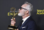 Bradley Whitford poses in the press room with the award for outstanding guest actor in a drama series for