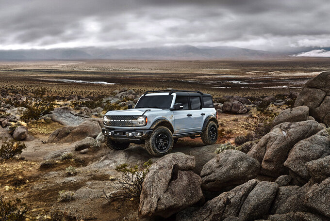 This photo provided by Ford Motor Company shows the 2022 Ford Bronco. The Bronco is an example of an off-road ready SUV with standard four-wheel-drive and rugged body-on-frame construction. (Courtesy of Ford Motor Co. via AP)