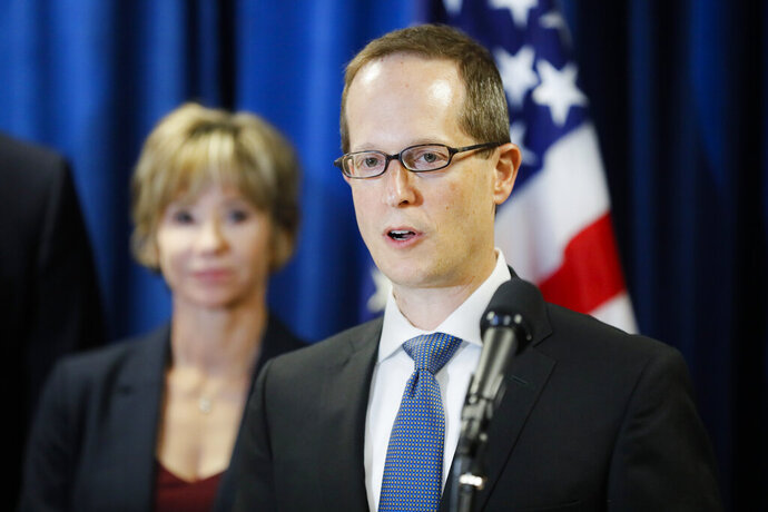 FILE - In this July 18, 2019 file photo Benjamin Glassman, the former United States Attorney of the Southern District of Ohio, speaks during a news conference in Cincinnati. Squire Patton Boggs announced Thursday, Feb. 20, 2020, that Glassman, who recently resigned, will be joining the global law firm as a partner. (AP Photo/John Minchillo, File)