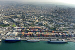 A drone picture shows a general view of containers are piled up at one of Beirut's seaport terminal, in Beirut, Lebanon, Nov. 30, 2018. In recent weeks, Lebanon has been looking for stronger economic relations with eastern countries including China, Iraq and Russia as western countries and oil-rich gulf states have abstained from helping Prime Minister Hassan Diab's government that is backed by Hezbollah and its allies. (AP Photo/Hussein Malla)