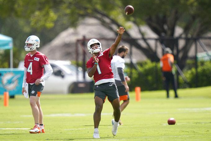 Miami Dolphins quarterback Tua Tagovailoa (1) does drills during NFL football practice, Tuesday, Aug. 17, 2021, in Miami Gardens, Fla. (AP Photo/Lynne Sladky)