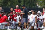 FILE - In this Aug. 2, 2019, file photo, Ohio State head coach Ryan Day talks with players during NCAA college football practice, in Columbus, Ohio. Day is taking over a program that went 83-9 in seven seasons under Meyer. The Buckeyes hardly needed a makeover and Day has not felt compelled to put his so-called stamp on Ohio State as he transitioned from offensive coordinator to head coach. (AP Photo/Jay LaPrete, File)