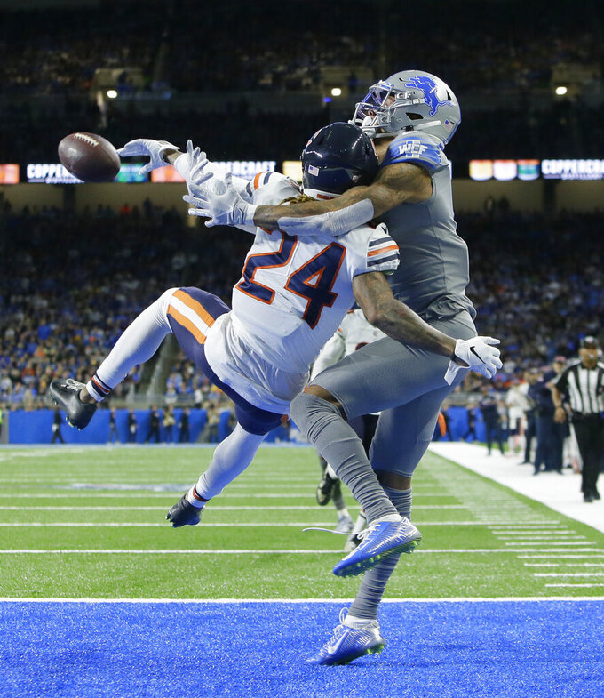 Chicago Bears cornerback Buster Skrine (24) and Detroit Lions wide receiver Kenny Golladay interfere with each other during the first half of an NFL football game, Thursday, Nov. 28, 2019, in Detroit. (AP Photo/Duane Burleson)