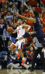 Virginia guard Kihei Clark (0) tries to get the ball down court as Notre Dame guard Prentiss Hubb (3) defends during the second half of an NCAA college basketball game in Charlottesville, Va., Saturday, Feb. 16, 2019. Virginia beat Notre Dame 60-54. (AP Photo/Steve Helber)