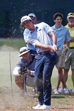 J.T. Poston hits out of the rough along the first fairway during the third round of the Sanderson Farms Championship golf tournament in Jackson, Miss., Saturday, Sept. 21, 2019. (AP Photo/Rogelio V. Solis)