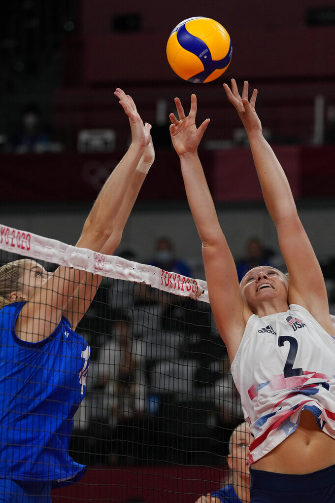 United States' Jordyn Poulter, right, and Irina Fetisova, of the Russian Olympic Committee, challenge for the ball during the women's volleyball preliminary round pool B match between United States and Russian Olympic Committee at the 2020 Summer Olympics, Saturday, July 31, 2021, in Tokyo, Japan. (AP Photo/Frank Augstein)