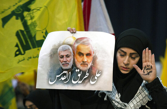 A supporter of Hezbollah leader Sayyed Hassan Nasrallah wears the words
