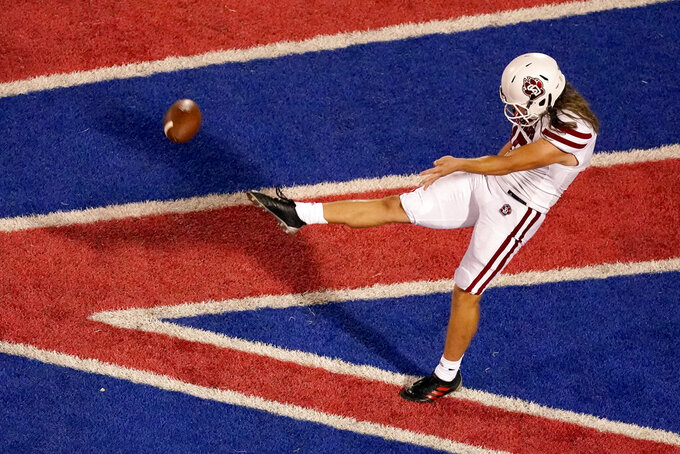 South Dakota punter Brady Schutt (15) punts the ball from the end zone during the first half of an NCAA college football game against Kansas Friday, Sept. 3, 2021, in Lawrence, Kan. (AP Photo/Charlie Riedel)