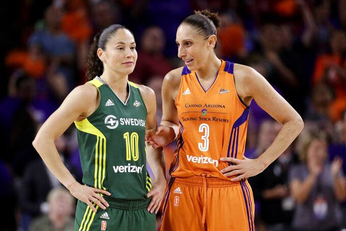 FILE - In this Sept. 6, 2017 file photo, Phoenix Mercury guard Diana Taurasi (3) talks with Seattle Storm guard Sue Bird (10) during the second half of a WNBA basketball playoff game in Tempe, Ariz. Taurasi and Bird will try and become the first players ever to win five Olympic gold medals in basketball when the United States women's team begins play at the Tokyo Games.(AP Photo/Matt York, File)