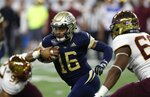 Georgia Tech quarterback TaQuon Marshall (16) scrambles during the first half of the Quick Lane Bowl NCAA college football game against Minnesota, Wednesday, Dec. 26, 2018, in Detroit. (AP Photo/Carlos Osorio)