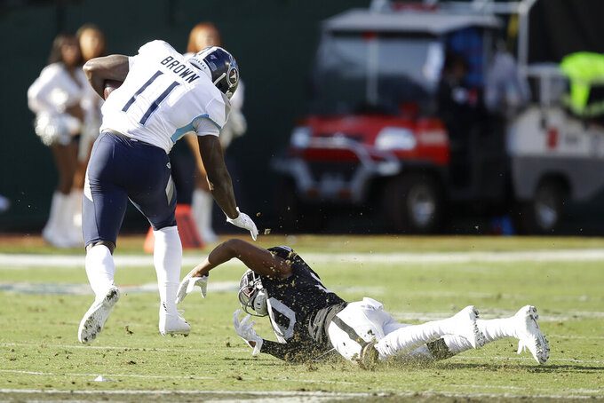 Tennessee Titans wide receiver A.J. Brown (11) runs past Oakland Raiders cornerback Daryl Worley to score during the first half of an NFL football game in Oakland, Calif., Sunday, Dec. 8, 2019. (AP Photo/Ben Margot)