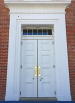 FILE- In this March 12, 2017 file photo the doors of the Lyceum, a building on the University of Mississippi campus in Oxford, Miss. The site is among about 130 locations in 14 states being promoted as part of the new U.S. Civil Rights Trail, which organizers hope will boost tourism in the region. (AP Photo/Beth J. Harpaz, File)