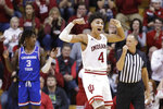 Indiana's Trayce Jackson-Davis (4) reacts after making a shot and getting fouled by Louisiana Tech's Amorie Archibald (3) during the second half of an NCAA college basketball game, Monday, Nov. 25, 2019, in Bloomington, Ind. Indiana won 88-75. (AP Photo/Darron Cummings)