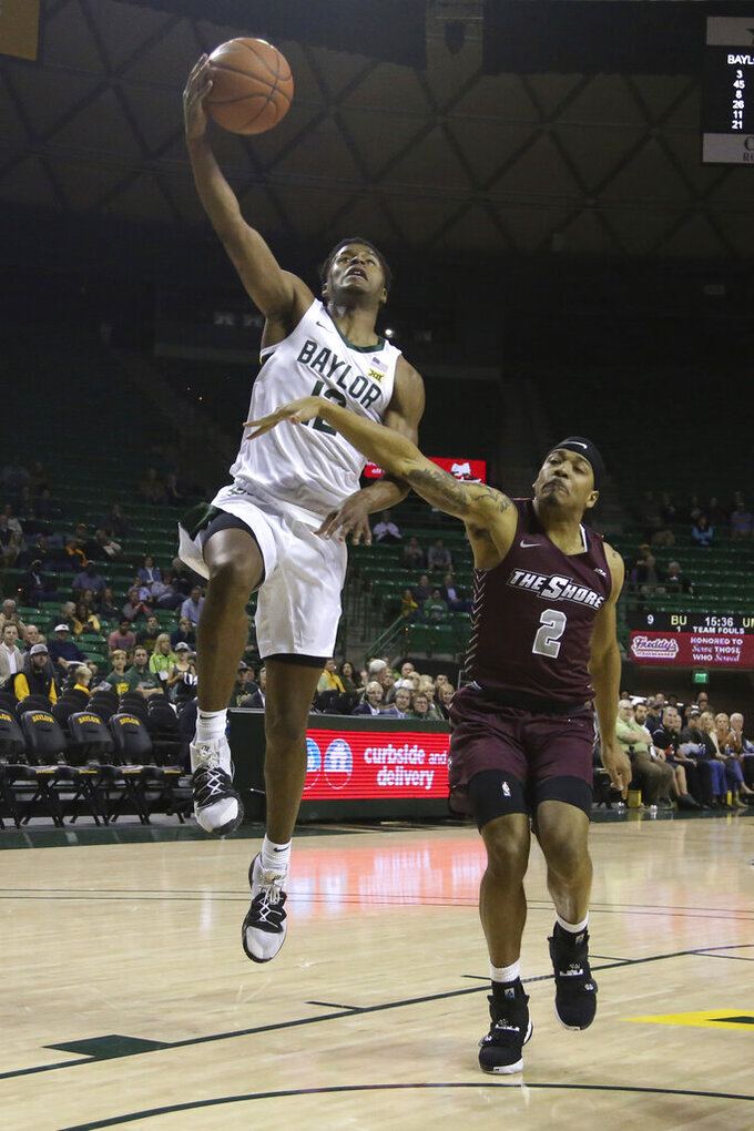 Baylor guard Jared Butler, left, scores over Maryland-Eastern Shore guard Ty Gibson, right, in the first half of an NCAA college basketball game, Tuesday, Dec. 3, 2019, in Waco, Texas. (AP Photo/Rod Aydelotte)