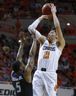 Oklahoma State guard Lindy Waters III (21) shoots over Kansas State guard Barry Brown Jr. (5) during the first half of an NCAA college basketball game in Stillwater, Okla., Saturday, Feb. 2, 2019. (AP Photo/Sue Ogrocki)