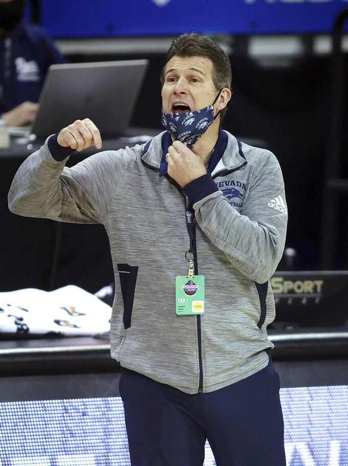 Nevada coach Steve Alford shouts to the team during the second half of an NCAA college basketball game against Boise State in the quarterfinals of the Mountain West Conference men's tournament Thursday, March 11, 2021, in Las Vegas. (AP Photo/Isaac Brekken)