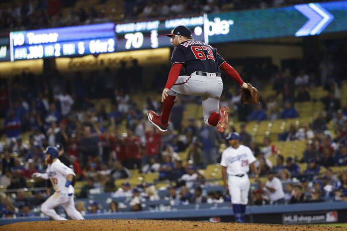 Washington Nationals relief pitcher Sean Doolittle celebrates after the Nationals' 7-3 win in Game 5 of a baseball National League Division Series against the Los Angeles Dodgers on Wednesday, Oct. 9, 2019, in Los Angeles. (AP Photo/Marcio Jose Sanchez)