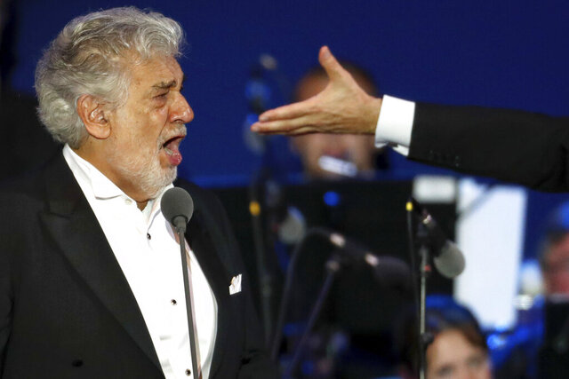 FILE - In this Wednesday, Aug. 28, 2019 file photo, opera star Placido Domingo performs during a concert in Szeged, Hungary. Domingo continued his calendar of European engagements despite allegations of sexual harassment, appearing here for a performance to inaugurate a sports complex for a local Catholic diocese. Two investigations into Domingo's behavior were opened in 2019 after Associated Press stories in which more than 20 women said the legendary tenor had pressured them into sexual relationships, behaved inappropriately and sometimes professionally punished those who rebuffed him. Dozens of others told the AP that they had witnessed his behavior. (AP Photo/Laszlo Balogh)
