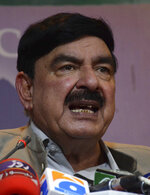 Pakistan's federal minister for railways Sheikh Rashid Ahmad addresses a news conference in Islamabad, Pakistan, Thursday, Aug. 8, 2019. Ahmad  said Thursday that Islamabad has suspended a key train service with neighboring India over change in Kashmir's special status by New Delhi. Ahmad said the Express, or Friendship Express, train service was suspended from Thursday. (AP Photo/B.K. Bangash)
