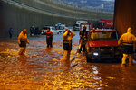 Civil Defense workers pump water out of a tunnel in Beirut's southern suburb of Ouzai, Lebanon, Monday, Dec. 9, 2019. A rainstorm paralyzed parts of Lebanon's capital Beirut on Monday, turning streets to small rivers, stranding motorists inside their vehicles and damaging homes in some areas.  (AP Photo/Bilal Hussein)