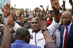 Spurned Congo opposition candidate Martin Fayulu greets supporters as he arrives at a rally in Kinshasha, Congo, Friday, Jan. 11, 2019. Hundreds gathered to denounce what they called