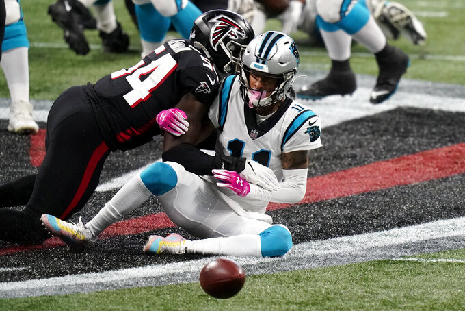 Carolina Panthers wide receiver Robby Anderson (11) misses the catch against Atlanta Falcons linebacker Foye Oluokun (54) during the first half of an NFL football game, Sunday, Oct. 11, 2020, in Atlanta. (AP Photo/Brynn Anderson)