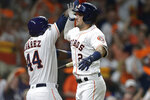Houston Astros' Alex Bregman (2) celebrates his solo home run against the Tampa Bay Rays with Yordan Alvarez during the fourth inning of Game 2 of a baseball American League Division Series in Houston, Saturday, Oct. 5, 2019. (AP Photo/Michael Wyke)