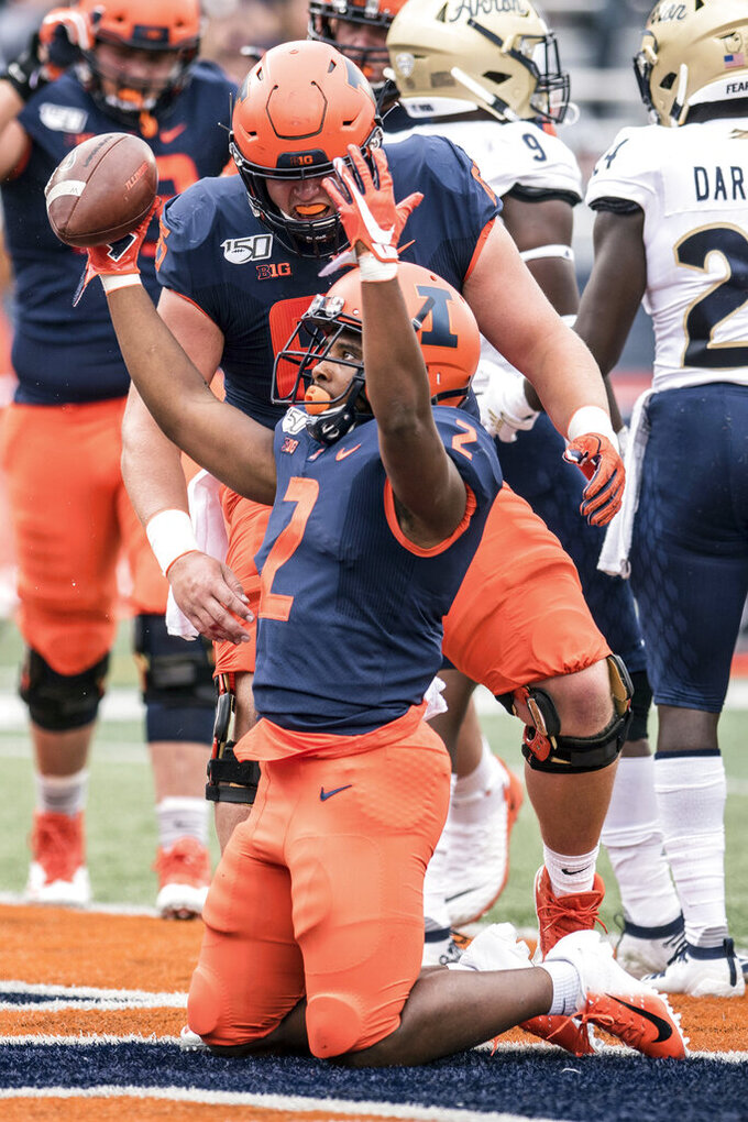 Illinois's Reggie Corbin celebrates a touchdown in the first half of a NCAA college football game between against Akron, Saturday, Aug. 31, 2019, in Champaign, Ill. (AP Photo/Holly Hart)