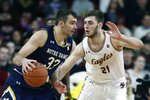 Notre Dame's John Mooney (33) drives past Boston College's Nik Popovic (21) during the first half of an NCAA college basketball game in Boston, Saturday, Feb. 2, 2019. (AP Photo/Michael Dwyer)