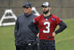 Carolina Panthers rookie quarterback Will Grier (3) stands with head coach Ron Rivera, left, during the NFL football team's rookie camp in Charlotte, N.C., Friday, May 10, 2019. (AP Photo/Chuck Burton)