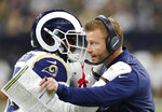 FILE- In this Jan. 20, 2019, file photo Los Angeles Rams head coach Sean McVay speaks with C.J. Anderson during the first half of the NFL football NFC championship game against the New Orleans Saints in New Orleans. The Los Angeles Rams and New England Patriots are bringing two of the top scoring offenses in the NFL to the Super Bowl. (AP Photo/John Bazemore, File)