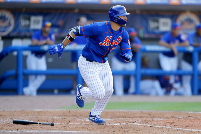 New York Mets' Tim Tebow runs out a ground out against the St. Louis Cardinals during the eighth inning of a spring training baseball game, Wednesday, March 4, 2020, in Port St. Lucie, Fla. (AP Photo/Julio Cortez)