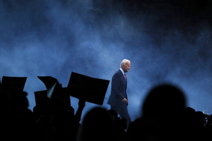 Democratic presidential candidate former Vice President Joe Biden walks on stage to speak at the Iowa Democratic Party's Liberty and Justice Celebration, Friday, Nov. 1, 2019, in Des Moines, Iowa. (AP Photo/Charlie Neibergall)