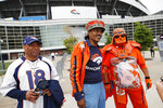 From left, Denver Broncos fans Clinton Mayfield, Ralph Williams and James Chavez head out of a five-hour memorial for team owner Pat Bowlen Tuesday, June 18, 2019 at Mile High Stadium, the NFL football team's home in Denver. Bowlen, who has owned the franchise for more than three decades, died last Thursday. (AP Photo/David Zalubowski)