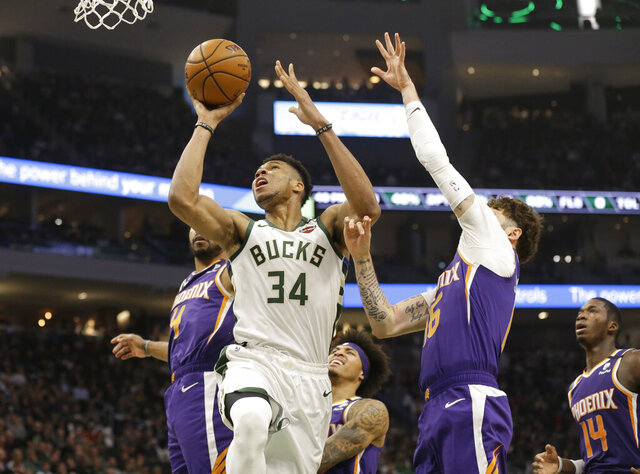 Milwaukee Bucks' Giannis Antetokounmpo (34) shoots against the Phoenix Suns during the first half of an NBA basketball game Sunday, Feb. 2, 2020, in Milwaukee. (AP Photo/Jeffrey Phelps)