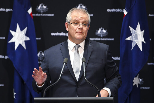 Australian Prime Minister Scott Morrison speaks to the media during a press conference at Parliament House in Canberra, Friday, May 1, 2020. Morrison stands firm on his call for an independent inquiry into the coronavirus and denied any motivation other than to prevent such a pandemic happening again. (Lukas Coch/AAP Image via AP)