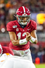 Alabama quarterback Tua Tagovailoa (13) sets the offense during the first half of an NCAA college football game against Tennessee, Saturday, Oct. 19, 2019, in Tuscaloosa, Ala. (AP Photo/Vasha Hunt)