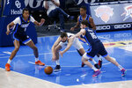 Dallas Mavericks forward Maxi Kleber (42) fights for the ball with Oklahoma City Thunder center Moses Brown (9), guard Ty Jerome (16) and guard Theo Maledon (11) during the first half of an NBA basketball game, Thursday, March 11, 2021, in Oklahoma City. (AP Photo/Garett Fisbeck)